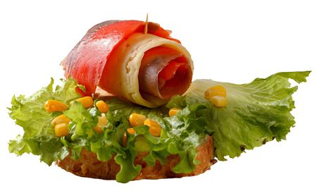 A sandwich with a roll of salmon and cheese, decorated with leaves of green lettuce and yellow corns. Isolated on a white background.