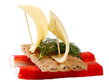 A sandwich with crab meat, baked grainy bread and cheese, made in a form of a sailing boat. Isolated on a white background.