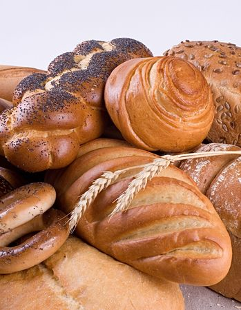 Variety of bread, bagels and two wheat-ears. photo