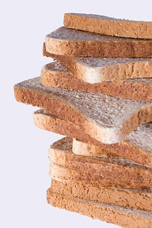 A stack of dietary bread slices, isolated on a white background. Stock Photo