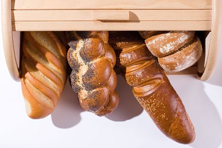A bread-basket full of bread on a white background. A view from above. Stock Photo