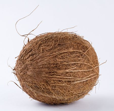 A coconut on a white background. Close-up.