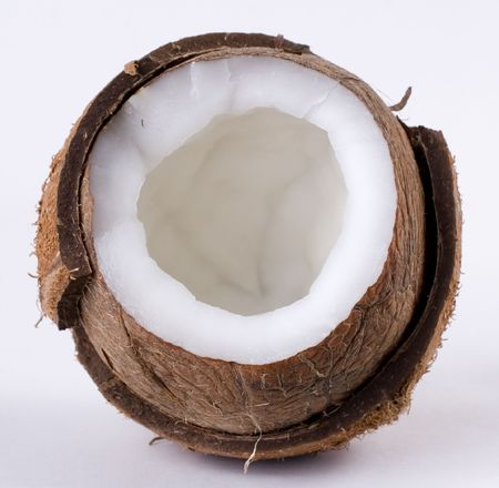 An open coconut on a white background. Close-up. Stock Photo