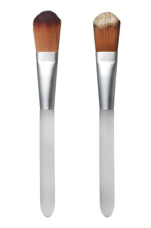 Beige liquid foundation makeup stroke with brush, isolated on white