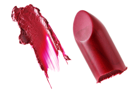 cutted: Crushed lipsticks isolated on white