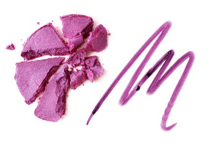 Eyeshadow violet and lipstick violet crushed and mixed isolated on a white background
