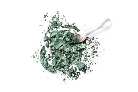 Crushed eyeshadow green isolated on white background Imagens