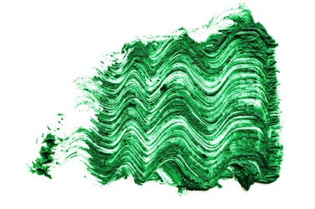 green color Mascara brush stroke on withe background Stock Photo