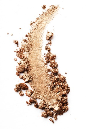 Crushed eyeshadow brown isolated on white background Imagens
