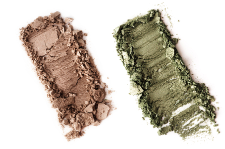 Crushed brown green eyeshadow isolated on white background Stock Photo