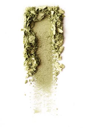 Crushed green eyeshadow isolated on white background