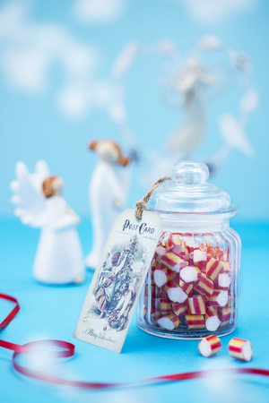 Christmas candy on blue background