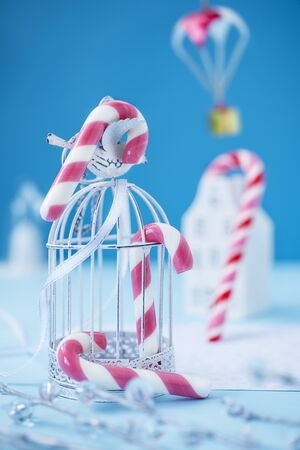 Candy canes on blue background.