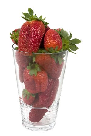 A jar filled by fresh strawberries