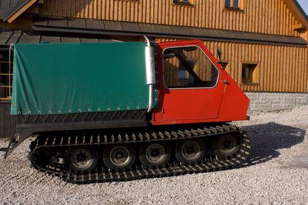transporter: Groomer transporter standing nearby cottage Stock Photo