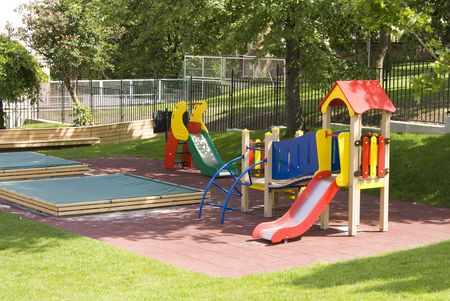 Childrens playground with teeter-totters, slide, sandpit