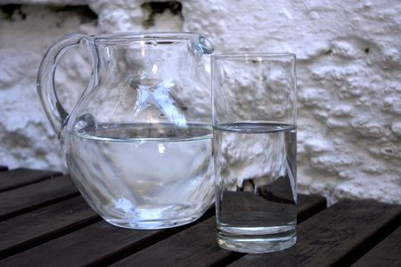 Glass and pitcher filled by water Stock Photo