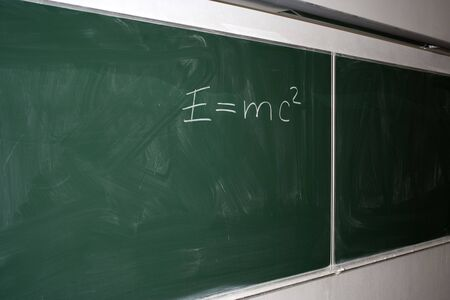 Classroom with green blackboard at university or college
