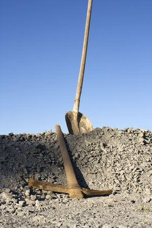 Shovel and pick on a heap of gravel Stock Photo