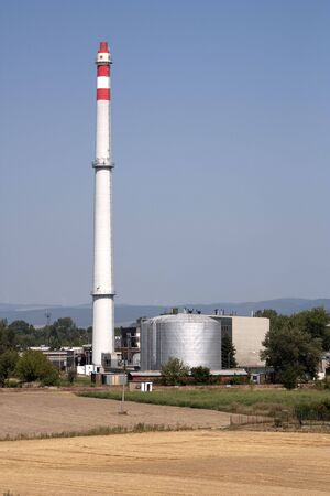smokestack: Smokestack and factory in fields