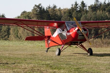 monoplane: Small airplane on an airfield