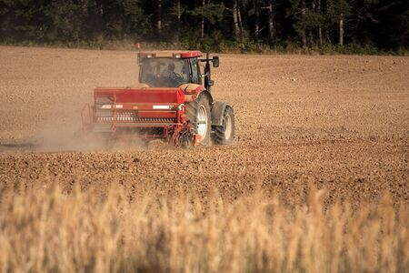Big tractor ploughing a field photo
