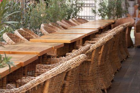 Rows of chairs in restaurant garden