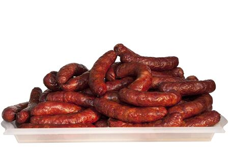 A plate with a large bunch of sausages Reklamní fotografie