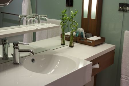 Hotel bathroom - clean white washbasin and faucet