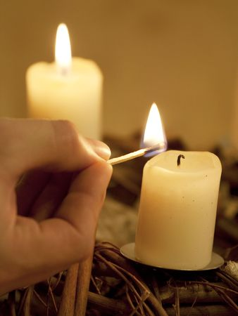 Advent garland - decoration with four burning candles