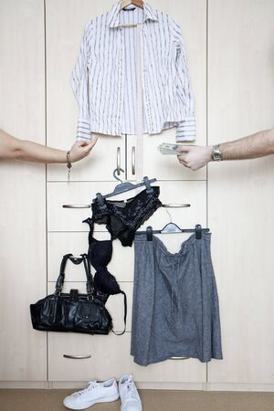 Husband giving money to a wife for clothes photo