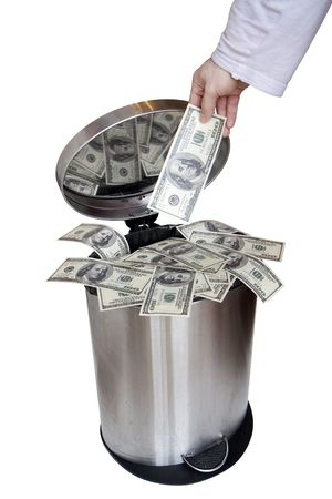 Wasting money - dollar bills in trashcan Stock Photo - 6483523