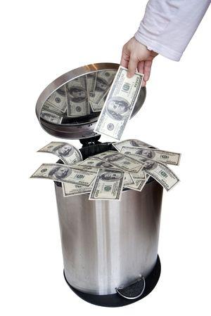 money in hands: Wasting money - dollar bills in trashcan Stock Photo