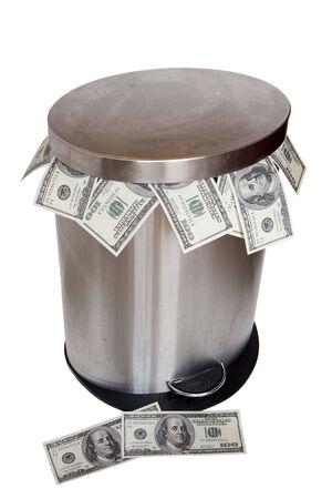 Wasting money - dollar bills in trashcan Stock Photo