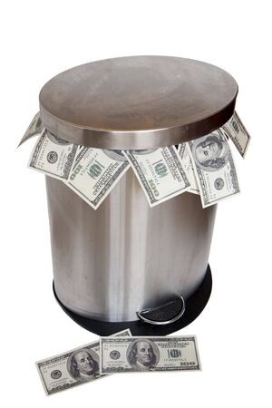 rid: Wasting money - dollar bills in trashcan Stock Photo