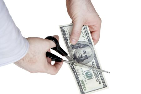 Cutting a hundred dollar bill in two parts Stock Photo