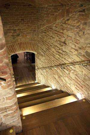 Brick hallway entrance to an undergound bar