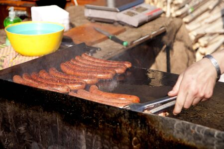 Roasting sausages on the street