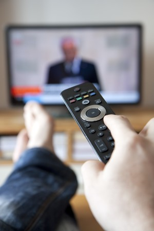 television remote: Watching tv and using remote controller
