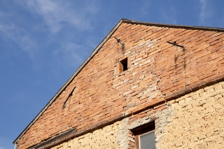house gable: Old house gable - bricks and clamps