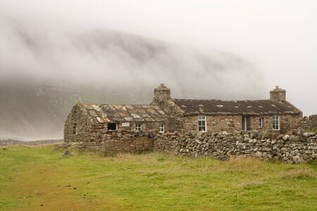 Hut of stone on an Orkney island photo