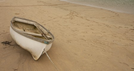 rowboat: Boat lying on a sandy beach