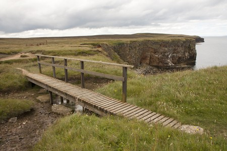 Wooden bridge and trail at Orkney islands photo