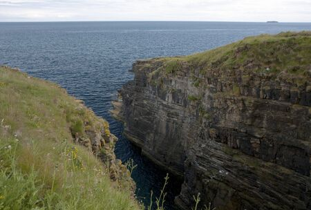 Rocks and cliffs at Orkney islands, Scotland photo
