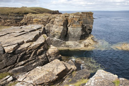 dropoff: Rocks and cliffs at Orkney islands, Scotland