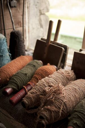 tortuous: Multiple color spools with thick flax threads Stock Photo