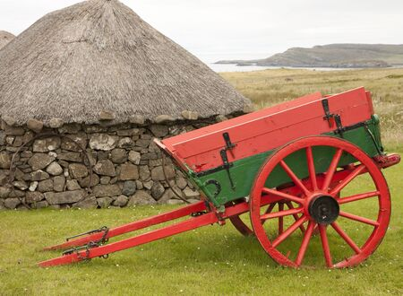 Cart and a hut in the Scotland country