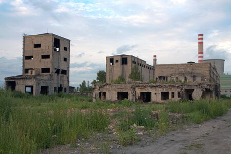 outworn: Abandoned factory - concrete ruins in industrial district