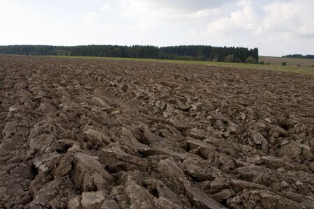 furrow: Ploughed field in the autumn - deep furrow Stock Photo