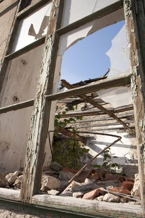 Ruined house - broken window and ceiling photo